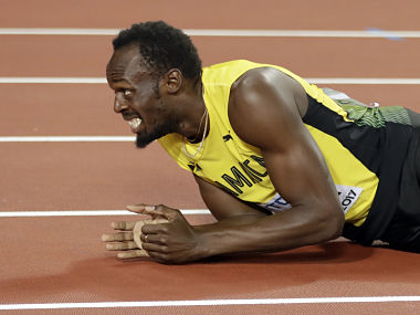 Jamaica's Usain Bolt lies on the track after injuring himself during the men's 4x100m final at the World Athletics Championships in London. AP