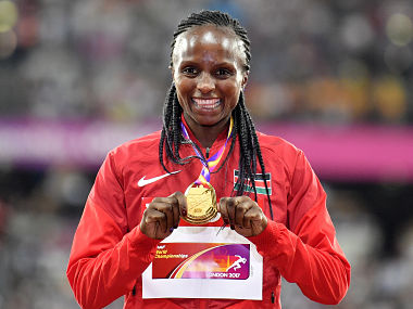 Kenya's Hellen Onsando Obiri stands on the podium after receiving her gold medal for the Women's 5000 meters at the World Athletics Championships in London Sunday, Aug. 13, 2017. (AP Photo/Martin Meissner)