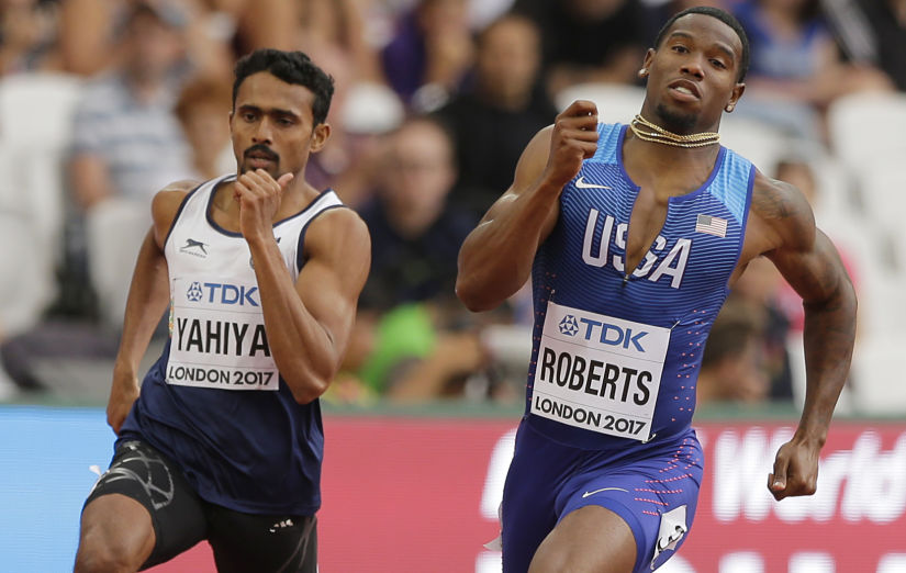 United States' Gil Roberts and India's Muhammed Anas Yahiya compete in Men's 400m first round heat. AP
