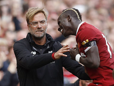 Liverpool's Sadio Mane celebrates his goal with manager Jurgen Klopp, during the Premier League against Crystal Palace. AP