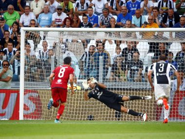 Soccer Football - Serie A - Juventus vs Cagliari - Turin, Italy - August 19, 2017 Cagliari's Diego Farias has a penalty saved by Juventus' Gianluigi Buffon REUTERS/Stefano Rellandini - RTS1CGJL