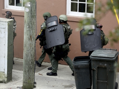 Members of the SWAT team surrounding the restaurant. AP