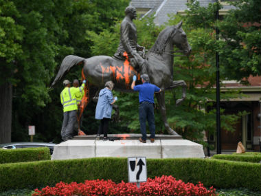 Municipal workers attempt to remove paint from a monument dedicated to Confederate soldier John B Castleman that was vandalised in Kentucky. Reuters