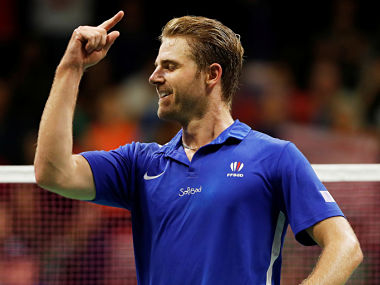 France's Brice Leverdez celebrates his victory over Malaysia's Lee Chong Wei. Reuters