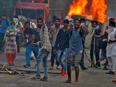 Dera Sacha Sauda members who indulged in large-scale arson and rioting. Reuters