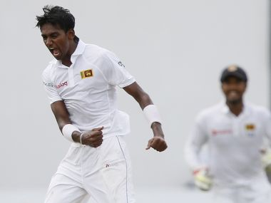 Sri Lanka's Dushmantha Chameera (front) celebrates with his teammates after taking the wicket of Pakistan's Asad Shafiq (not pictured) during the fourth day of their second test cricket match in Colombo June 28, 2015. REUTERS/Dinuka Liyanawatte - RTX1I45I