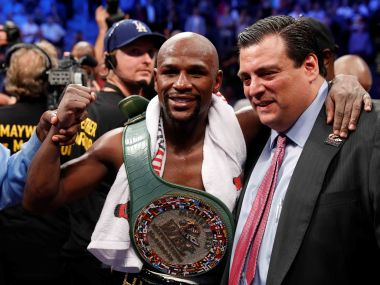 Floyd Mayweather celebrates with the Money Belt and President of the WBC Mauricio Sulaiman after winning the fight. Reuters