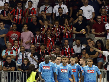 Napoli's Jose Callejon, third from left, celebrates with teammates after scoring during a Champions League playoff round, second leg soccer match between Nice and Napoli in Nice, France, Tuesday, Aug. 22, 2017. (AP Photo/Claude Paris)