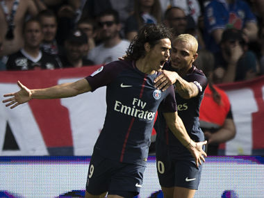 PSG's Edison Cavani, left, and PSG's Layvin Kurzawa celebrate after scoring against Amiens during the French League One soccer match between Paris Saint Germain and Amiens at the Parc des Princes stadium in Paris, France, Saturday, Aug. 5, 2017. (AP Photo/Kamil Zihnioglu)