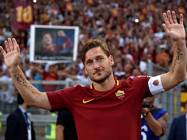 AS Roma's Francesco Totti waves to supporters after his final game. Reuters