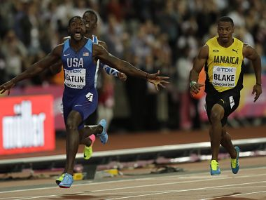 United States' Justin Gatlin celebrates after crossing the line to win the gold medal in the Men's 100m final. AP