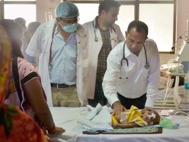 Doctor examining a child at the BRD hospital in Gorakhpur. PTI