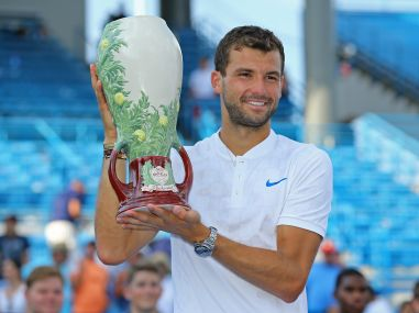 Grigor Dimitrov holds the Rookwood Cup after defeating Nick Kyrgios in the Cincinnati final. Reuters