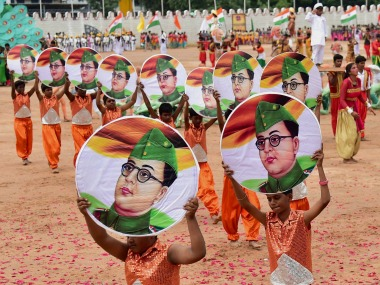 Children carry posters of freedom fighter Subhash Chandra Bose during the celebrations on the occasion of 71st Independence day at Parade Ground in Bengaluru on Tuesday. PTI
