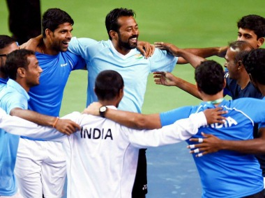 Indian team players celebrate after their victory over New Zealand in a Davis Cup tennis match , in Pune on Sunday. PTI Photo by Shashank Parade (PTI2_5_2017_000227B)