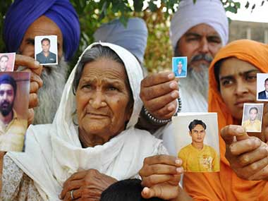 File image of the relatives of the missing Indians. AFP