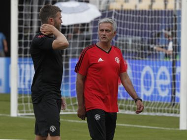 Manchester United's manager Jose Mourinho, center, talks to the captain Michael Carrick, left, during a training session at Philip II Arena in Skopje, Macedonia, Monday, Aug. 7, 2017, a day ahead of UEFA Super Cup final soccer match with Real Madrid. (AP Photo/Boris Grdanoski)