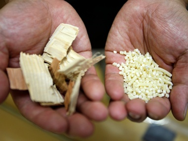 Kyoto University Professor Hiroyuki Yano, shows wood chips (L) and fibers before they are converted into cellulose nanofibers. Reuters.
