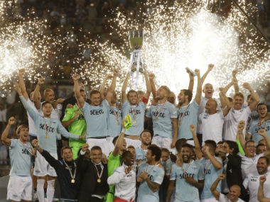 Lazio's captain Senad Lulic, center, raises the trophy at the end of the Italian Super Cup final match between Lazio and Juventus at Rome's Olympic stadium. AP