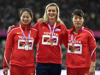Women's javelin gold medallist Barbora Spotakova, centre, stands with silver medallist Li Lingwei, left, and bronze medallist Lyu Huihui. AP