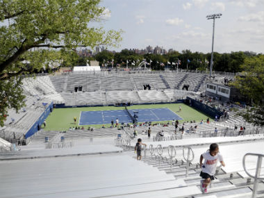 Children climb the bleachers at the temporary Louis Armstrong Stadium at US Open. AP