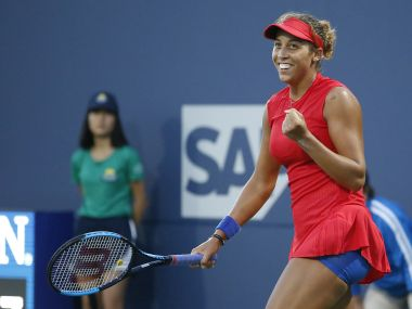 Madison Keys, of the United States, smiles after a victory over Garbine Muguruza, of Spain, during the semifinals of the Bank of the West Classic tennis tournament in Stanford, Calif., Saturday, Aug. 5, 2017. (AP Photo/Tony Avelar)