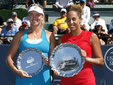 Madison Keys holds the winner's plate next to Coco Vandeweghe with the runner-up plate. AP