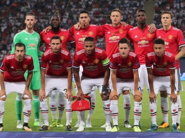 Manchester United players pose for a team photo before the UEFA super Cup match. Reuters