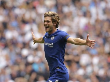 Chelsea's Marcos Alonso celebrates after scoring the opening goal of the game during their English Premier League soccer match between Tottenham Hotspur and Chelsea at Wembley stadium in London, Sunday Aug. 20, 2017. (AP Photo/Alastair Grant)