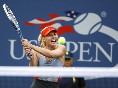 FILE - In this Aug. 27, 2014, file photo, Maria Sharapova, of Russia, returns a shot to Alexandra Dulgheru, of Romania, during the second round of the U.S. Open tennis tournament, in New York. Sharapova has been granted a wild-card invitation for the U.S. Open's main draw. Sharapova is among eight women who were given entry into the 128-player field by the U.S. Tennis Association on Tuesday, Aug. 15, 2017, and by far the most noteworthy. (AP Photo/Jason DeCrow, File)