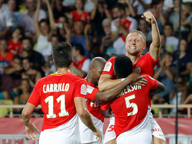 Monaco's Kamil Glik celebrates with teammates after scoring team's third goal. Reuters