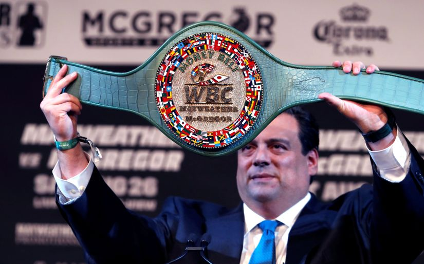 """WBC President Mauricio Sulaiman holds up the """"Money Belt"""" during a news conference with undefeated boxer Floyd Mayweather and UFC lightweight champion Conor McGregor in Las Vegas. Reuters"""