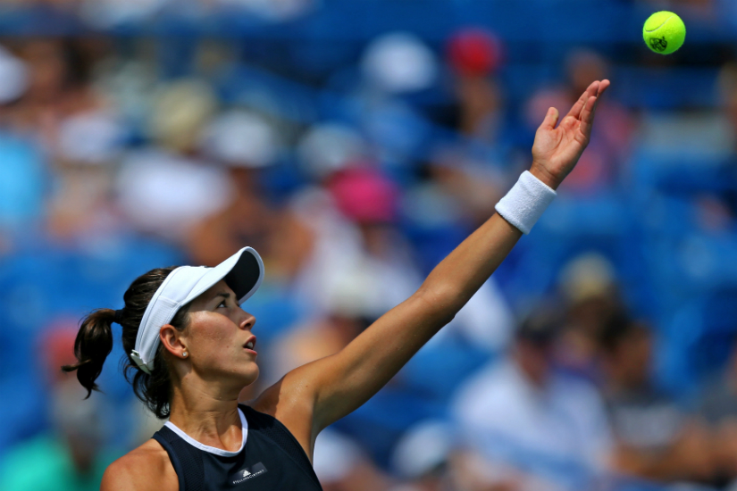Kerber goes from champ to 1st-round loser at rainy US Open