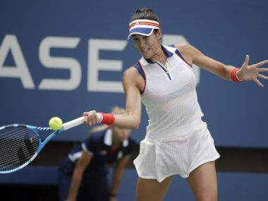 Garbine Muguruza, of Spain, returns a shot from Varvara Lepchenko, of the United States, during the first round of the U.S. Open tennis tournament, Monday, Aug. 28, 2017, in New York. (AP Photo/Seth Wenig)