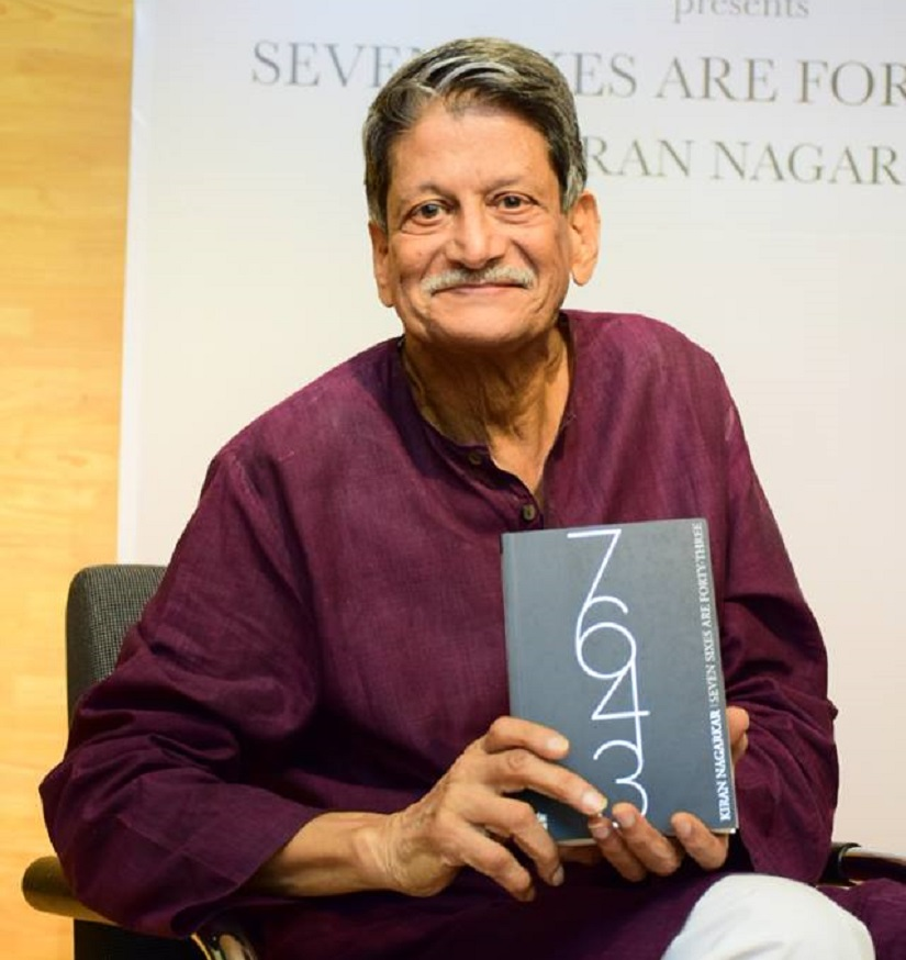 Kiran Nagarkar poses with his re-released book . Image from Facebook