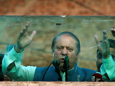 Deposed Pakistani Prime Minister Nawaz Sharif addresses his supporters behind glass during a rally. AP