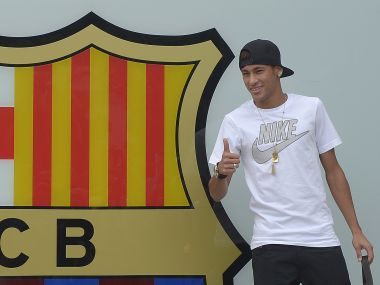 FILE- In this Monday, June 3, 2013 file photo, the then FC Barcelona's new signing Neymar gestures upon his arrival at the club's office at the Camp Nou stadium in Barcelona, Spain. Barcelona said Wednesday, Aug. 2, 2017, Neymar's 222 million euro ($262 million) release clause must be paid in full if the Brazil striker wants to leave. (AP Photo/Manu Fernandez, File)