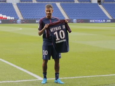 Brazilian soccer star Neymar holds his team shirt following a press conference in Paris Friday, Aug. 4, 2017. Neymar arrived in Paris on Friday the day after he became the most expensive player in soccer history when completing his blockbuster transfer to Paris Saint-Germain from Barcelona for 222 million euros ($262 million). (AP Photo/Michel Euler)