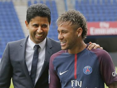 Brazilian soccer star Neymar walks away with the chairman of Paris Saint-Germain Nasser Al-Khelaifi, left, following a press conference in Paris Friday, Aug. 4, 2017. Neymar arrived in Paris on Friday the day after he became the most expensive player in soccer history when completing his blockbuster transfer to Paris Saint-Germain from Barcelona for 222 million euros ($262 million). (AP Photo/Michel Euler)