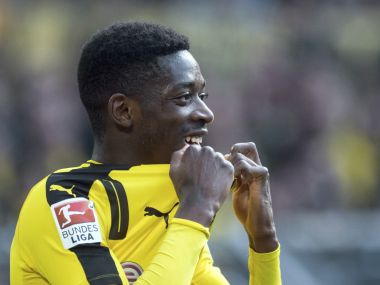 "FILE - In this April 29 2017 file photo, Dortmund's Ousmane Dembele attends the Bundesliga soccer match between Borussia Dortmund and 1. FC Cologne in Dortmund. Borussia Dortmund says Sunday Aug. 13, 2017 France forward Ousmane Dembele remains suspended from team training ""until further notice"" as he agitates for a move to Barcelona. Dembele has reportedly refused all contact with the club since Barcelona made a bid reported to be worth 105 million euros ($124 million) including add-ons. (Bernd Thissen/dpa via AP,file)"