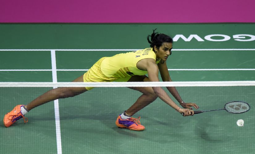 PV Sindhu lunges for a return against Nozomi Okuhara during their women's singles final at 2017 World Championships. AFP