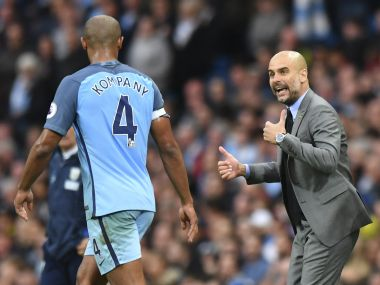 Vincent Kompany (L) must stay fit for a longer period this season to help Pep Guardiola take Manchester City to the title. AFP