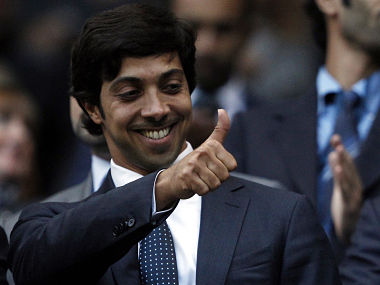"""Manchester City's owner Sheik Mansour bin Zayed Al Nahyan gestures ahead of their English Premier League soccer match against Liverpool at the City of Manchester stadium in Manchester, northern England, August 23, 2010. REUTERS/Darren Staples (BRITAIN - Tags: SPORT SOCCER BUSINESS) FOR EDITORIAL USE ONLY. NOT FOR SALE FOR MARKETING OR ADVERTISING CAMPAIGNS. NO USE WITH UNAUTHORIZED AUDIO, VIDEO, DATA, FIXTURE LISTS, CLUB/LEAGUE LOGOS OR """"LIVE"""" SERVICES. ONLINE IN-MATCH USE LIMITED TO 45 IMAGES, NO VIDEO EMULATION. NO USE IN BETTING, GAMES OR SINGLE CLUB/LEAGUE/PLAYER PUBLICATIONS - RTR2HH0N"""