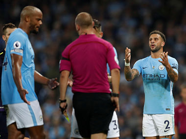 """Football Soccer - Premier League - Manchester City vs Everton - Manchester, Britain - August 21, 2017 Manchester City's Kyle Walker reacts after receiving a second booking and being sent off by referee Robert Madley Action Images via Reuters/Carl Recine EDITORIAL USE ONLY. No use with unauthorized audio, video, data, fixture lists, club/league logos or """"live"""" services. Online in-match use limited to 45 images, no video emulation. No use in betting, games or single club/league/player publications. Please contact your account representative for further details. TPX IMAGES OF THE DAY - RTS1CPZI"""