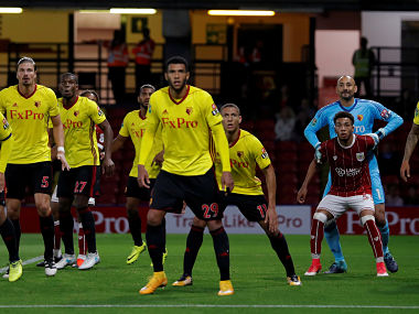 """Soccer Football - Carabao Cup Second Round - Watford vs Bristol City - Watford, Britain - August 22, 2017 Watford's Etienne Capoue, Heurelho Gomes and teammates with Bristol City's Freddie Hinds in the penalty area Action Images via Reuters/Andrew Couldridge EDITORIAL USE ONLY. No use with unauthorized audio, video, data, fixture lists, club/league logos or """"live"""" services. Online in-match use limited to 45 images, no video emulation. No use in betting, games or single club/league/player publications. Please contact your account representative for further details. TPX IMAGES OF THE DAY - RTS1CW6Y"""