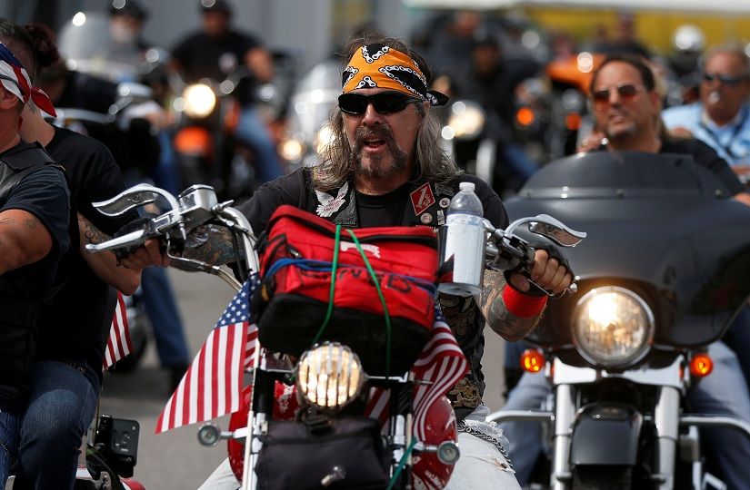 Daryl Rembowski prepares to ride to a Bikers for Trump rally in Cleveland, Ohio, U.S., July 18, 2016. REUTERS/Jim Urquhart - RTSIK1P