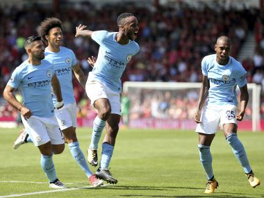 Manchester City's Raheem Sterling, center, celebrates scoring his side's second goal during the Premier League soccer match between AFC Bournemouth and Manchester City at the Vitality Stadium, Bournemouth, England. Saturday Aug. 26, 2017. (Steve Paston/PA via AP)