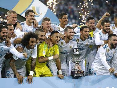 Real Madrid's players pose with the trophy after winning the Spanish Super Cup against Barcelona. AP