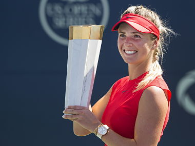 Elina Svitolina of Ukraine poses for photographs with the trophy after defeating Caroline Wozniacki of Denmark during women's final Rogers Cup the trophy tennis action in Toronto on Sunday, Aug. 13, 2017. (Nathan Denette/The Canadian Press via AP)