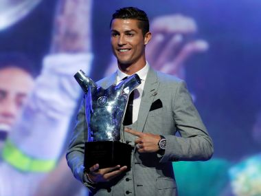 Real Madrid's Cristiano Ronaldo with the UEFA Men's Player of the Season award. Reuters